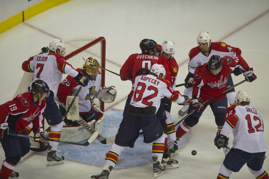 Mike Green (52) of the Washington Capitals navigates the puck through Florida Panthers defenders in the first period as the Capitals host the Panthers at the Verizon Center in Washington,D.C., Tuesday, October 18, 2011. (Rod Lamkey Jr/The Washington Times)