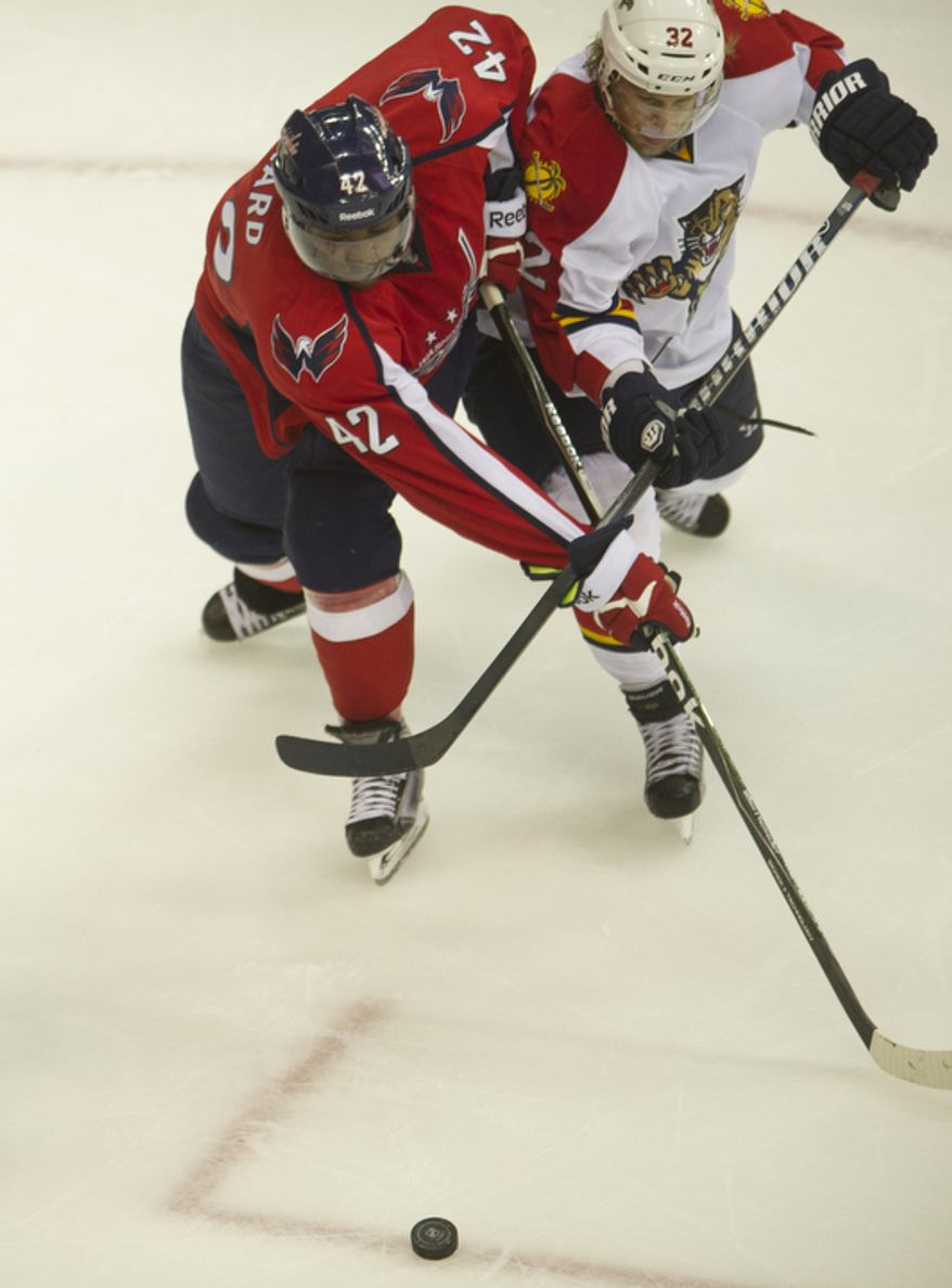 Joel ward (42) of the Washington Capitals races to the puck against Kris Versteeg (32) of the Florida Panthers in the second period as the Capitals host the Panthers at the Verizon Center in Washington,D.C., Tuesday, October 18, 2011. (Rod Lamkey Jr/The Washington Times)