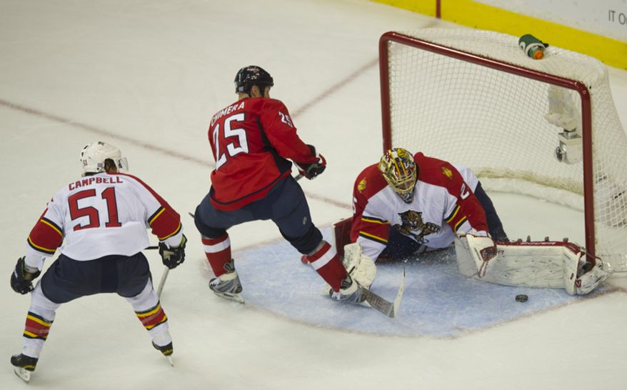 Jason Chimera (25) of the Washington Capitals tries to score against Florida Panthers goalie Jacob Markstrom in the second period as the Capitals host the Panthers at the Verizon Center in Washington,D.C., Tuesday, October 18, 2011. (Rod Lamkey Jr/The Washington Times)