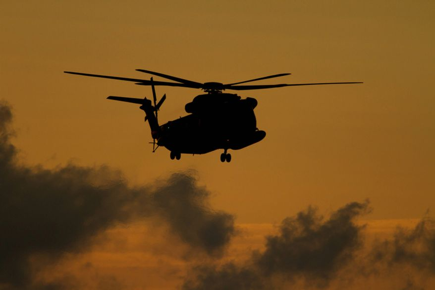 An Israeli military Helicopter carrying released soldier Gilad Schalit lands in Mitzpe Hila, northern Israel,Tuesday, Oct. 18, 2011 .  (AP Photo/Ariel Schalit)