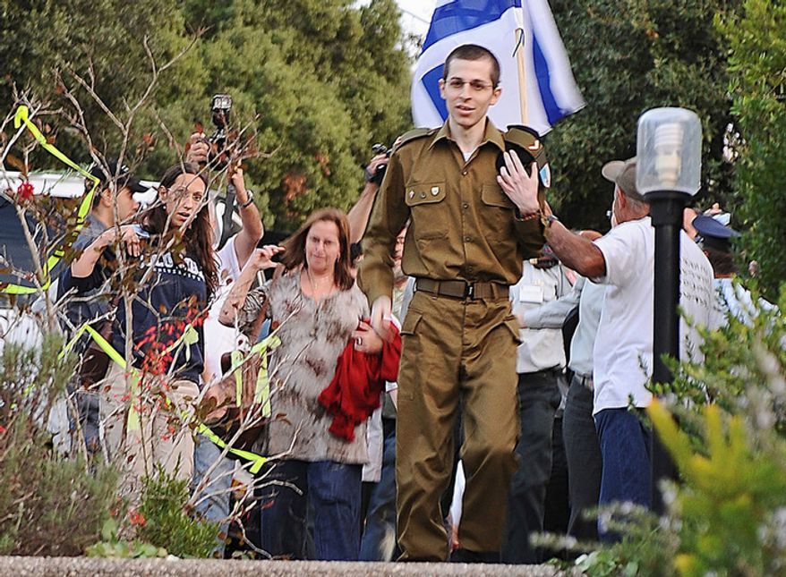 Released Israeli soldier Gilad Schalit walks down the stairs into his home in Mitzpe Hila, northern Israel, after over five years in captivity, Tuesday, Oct. 18, 2011.  (AP Photo/ IDF)