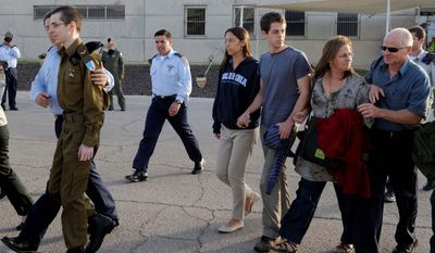 Released Israeli soldier Gilad Schalit, left, is followed by from right: parents Noam and Aviva, brother Yoel and Yoel's girlfriend Yaara Winkler at the Tel Nof Air base in southern Israel (AP Photo/Israeli Defense Ministry)