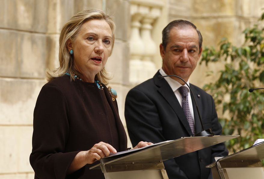 U.S. Secretary of State Hillary Rodham Clinton and Maltese Prime Minister Lawrence Gonzi make remarks following their meeting in Valletta, Malta, on Tuesday, Oct. 18, 2011. Mrs. Clinton thanked Maltese authorities for their assistance in relief and evacuation efforts during the recent crisis in Libya. (AP Photo/Kevin Lamarque, Pool)