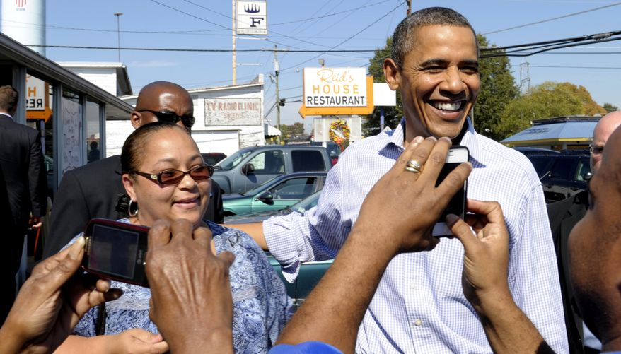 President Obama greets people outside the Reid's House Restaurant in Reidsville, N.C., on Oct. 18, 2011. Obama is on a three-day bus tour promoting the American Jobs Act. (Associated Press)