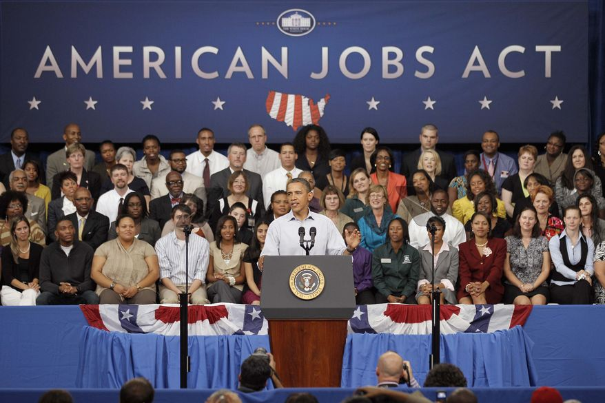 President Obama delivers remarks at the YMCA at Guilford Technical Community College in Jamestown, N.C., on Tuesday, Oct. 18, 2011, during his three-day bus tour through North Carolina and Virginia. (AP Photo/Gerry Broome)