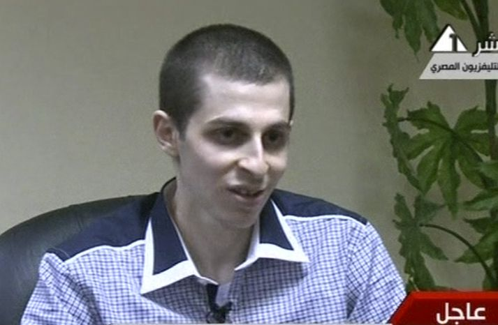 In this image from Egypt TV on Tuesday, Oct. 18, 2011, Israeli soldier Gilad Schalit is seen at an undisclosed location during a pre-recorded interview. (AP Photo/Egypt TV)