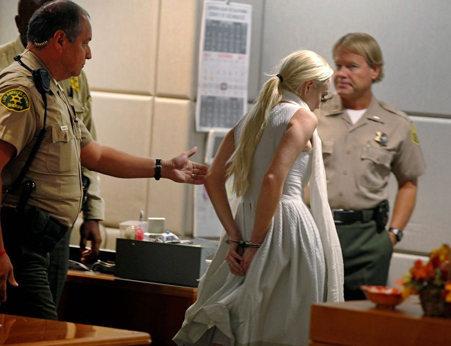 Lindsay Lohan is arrested by Los Angeles County sheriff's deputies after a judge finds her in violation of probation on Wednesday in Los Angeles. Bail has been set at $100,000. (Associated Press)