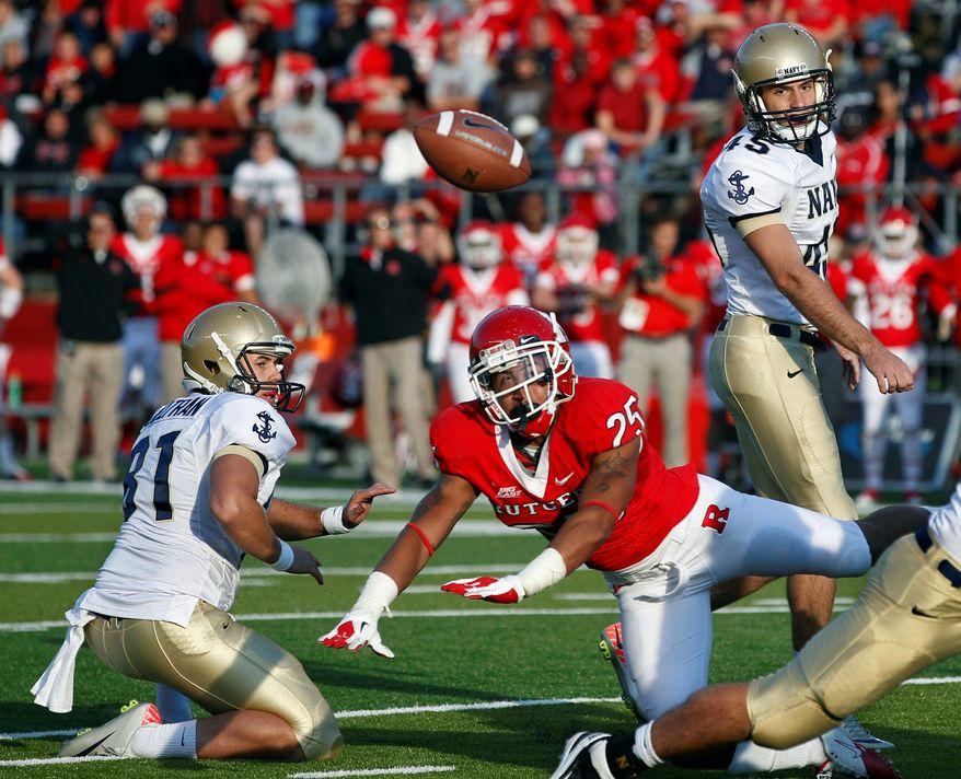 Rutgers defensive back Brandon Jones blocked a 41-yard field goal attempt by Navy kicker Jon Teague as the Scarlet Knights held on for a 21-20 win Saturday. (Associated Press)