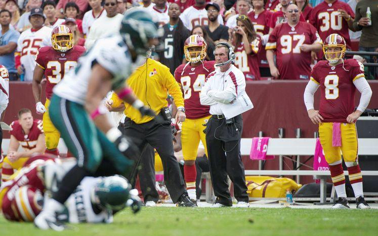 Redskins quarterback Rex Grossman (8) watched the defense from the sideline against Philadelphia on Sunday. He'll be on the sideline this week when Washington visits Carolina. (Rod Lamkey Jr./The Washington Times)