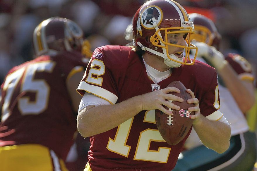 Washington Redskins quarterback John Beck scrambles with the football during the second half of an NFL football game against Philadelphia Eagles in Landover, Md., Sunday, Oct. 16, 2011. (AP Photo/Pablo Martinez Monsivais)