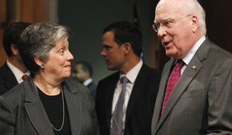 Homeland Security Secretary Janet Napolitano speaks with Sen. Patrick J. Leahy (right), Senate Judiciary Committee chairman, prior to her testimony before the panel on Wednesday, Oct. 19, 2011, on Capitol Hill in Washington. (AP Photo/Haraz N. Ghanbari)