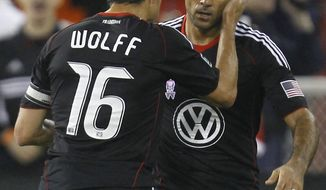 United acquired Dwayne de Rosario (right) from the Red Bulls midway through last season, and he went on to score 13 goals in 18 matches in an MVP season. (AP Photo/Luis M. Alvarez)
