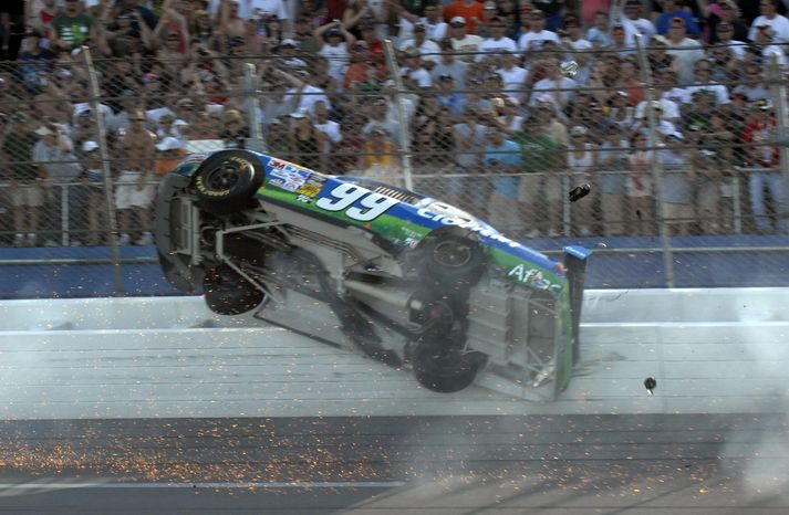 This April 26, 2009, file photo shows Carl Edwards hitting the fence during a crash on the last lap of the Aaron's 499 NASCAR Sprint Cup Series race at Talladega Superspeedway, in Talladega, Ala. The death of Indianapolis 500 winner Dan Wheldon has sparked safety discussions throughout motorsports just as NASCAR heads to one of the fastest tracks on its circuit. (AP Photo/Rainier Ehrhardt)