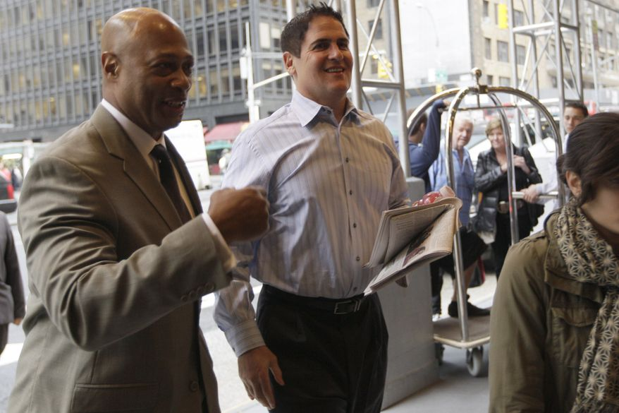 Dallas Mavericks owner Mark Cuban, right, arrives for labor talks between the NBA and the players' association, Tuesday, Oct. 18, 2011, in New York. (AP Photo/Mary Altaffer)