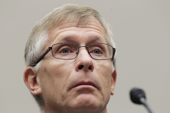 Chief Financial Officer W.G. Stover from the bankrupt solar energy company Solyndra refuses to answer questions as he appears before the House Energy Commitee's Oversight and Investigations Subcommittee on Sept. 23 2011. (AP Photo/J. Scott Applewhite)