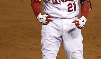 St. Louis Cardinals' Allen Craig reacts after hitting an RBI single during the sixth inning of Game 1 of the World Series against the Texas Rangers on Wednesday, Oct. 19, 2011, in St. Louis. (AP Photo/Eric Gay)