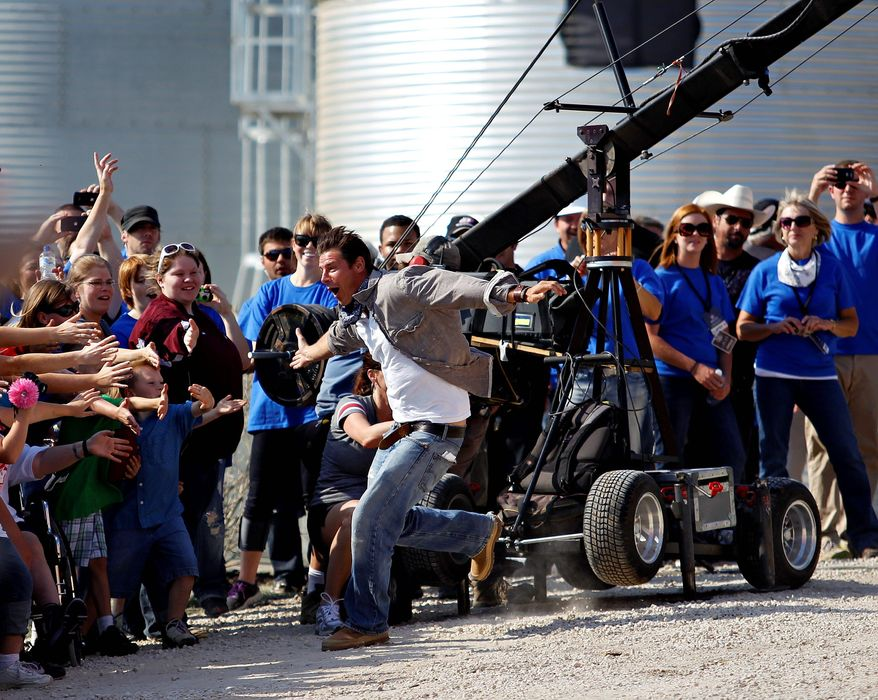 """Host Ty Pennington and the """"Extreme Makeover: Home Edition"""" crew's latest project is to build seven homes in seven days in Joplin, Mo. The community was devastated by a May 22 tornado that killed 162 people. (Waterloo Courier via Associated Press)"""