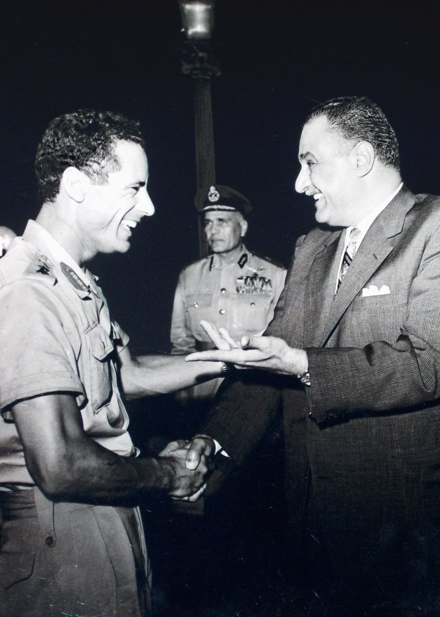 Col. Moammar Gadhafi (left) is greeted by Egyptian Prime Minister Gamal Abdel Nasser during the dictator's first visit to Egypt after his military coup in Libya.