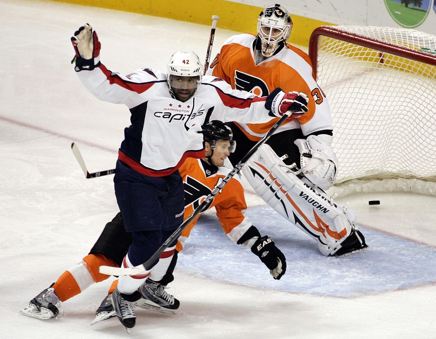 ** FILE ** Washington Capitals' Joel Ward reacts after scoring a goal against the Philadelphia Flyers on Thursday, Oct. 20, 2011, in Philadelphia. The Capitals won 5-2. (AP Photo/Tom Mihalek)
