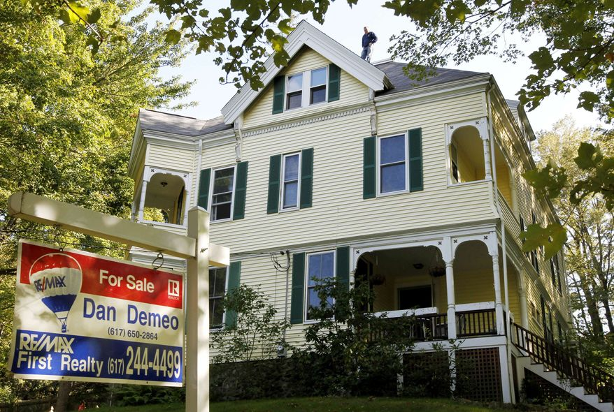 This Sept. 19, 2011, photo, shows a home with a for sale sign in front, in Newton, Mass. The number of Americans who bought previously occupied homes rose in August. But sales were driven by an increase in foreclosures, evidence the housing market remains weak. (AP Photo/Steven Senne)
