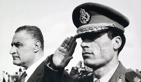 In this photo from 1969, Col. Moammar Gadhafi (right) salutes as he appears with Egypt Prime Minister Gamal Abdel Nasser in Suez, Egypt. (Associated Press)