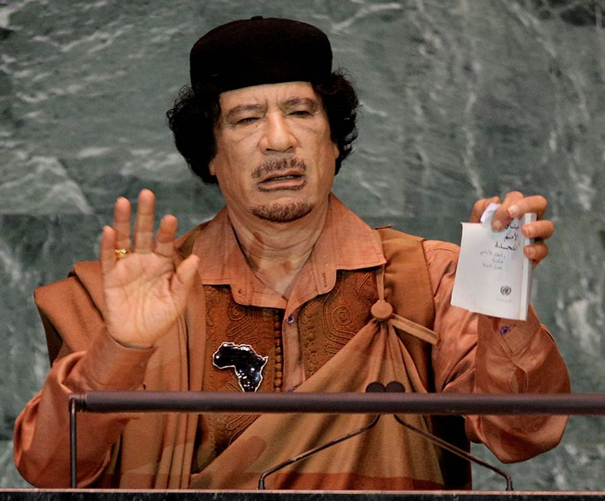 In this photo from Sept. 23, 2009, Libyan leader Col. Moammar Gadhafi shows a torn copy of the United Nations Charter during his address to the 64th session of the U.N. General Assembly. (Associated Press)