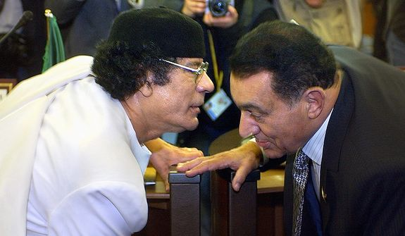 In this photo from March 22, 2005, Libyan leader Col. Moammar Gadhafi (left) confers with Egyptian President Hosni Mubarak during the opening session of the 17th League of Arab States' summit in Algiers, Algeria. (Associated Press)