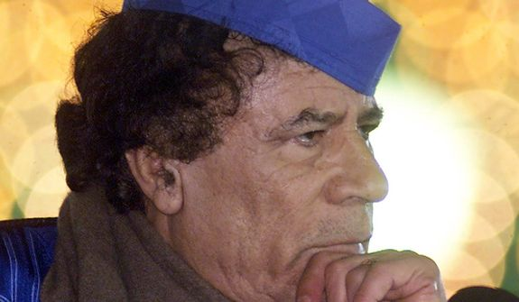 In this photo from Feb. 5, 2001, Libyan leader Col. Moammar Gadhafi listens to questions during a news conference in Tripoli. (Associated Press)
