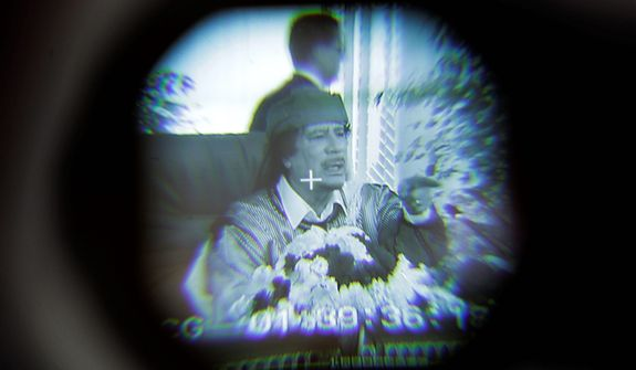 In this photo from March 2, 2011, Libyan leader Col. Moammar Gadhafi is seen through a television camera viewfinder as he speaks in Tripoli, Libya. (Associated Press)