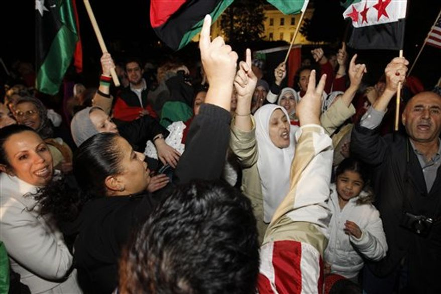 Libyan-Americans celebrate the death of Col. Moammar Gadhafi on Pennsylvania Avenue in front of the White House on Oct. 20, 2011. (Associated Press)