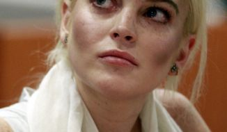 Lindsay Lohan is shown in court before being taken into custody by Los Angeles Country sheriffs deputies after a judge found her in violation of probation on Oct. 19, 2011. (Associated Press)
