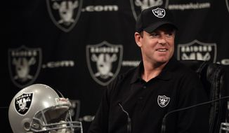 Quarterback Carson Palmer is introduced after signing with the Oakland Raiders on Tuesday, after starter Jason Campbell broke his collarbone. (AP Photo/Marcio Jose Sanchez)