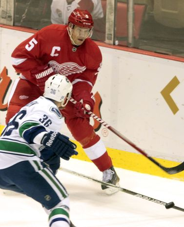 Detroit Red Wings' Nicklas Lidstrom will play in his 1,500 career game against the Washington Capitals on Saturday. (AP Photo/Jerry S. Mendoza)