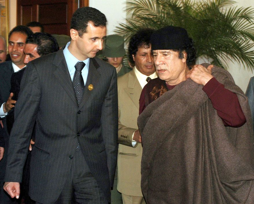** FILE ** In this March 22, 2005, photo, Syrian President Bashar Assad, left, talks to Libyan leader Moammar Gadhafi prior the 17th League of Arab States' summit in Algiers. (AP Photo/Nabil)