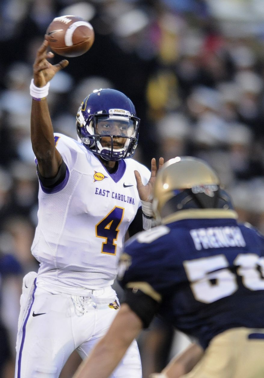 East Carolina quarterback Dominique Davis went 40-for-45 for 372 yards and two touchdowns against Navy on Saturday. East Carolina won 38-35. (AP Photo/Gail Burton)