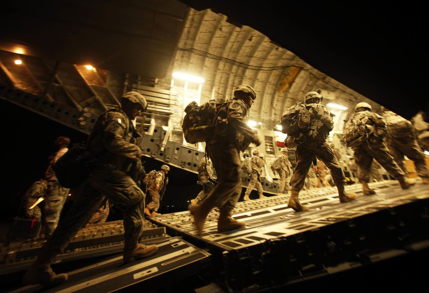 ** FILE ** In this Tuesday, July 13, 2010, file photo, U.S. Army soldiers from 2nd Brigade, 10th Mountain Division board a C-17 aircraft at Baghdad International Airport as they begin their journey to the United States. (AP Photo/Maya Alleruzzo, File)