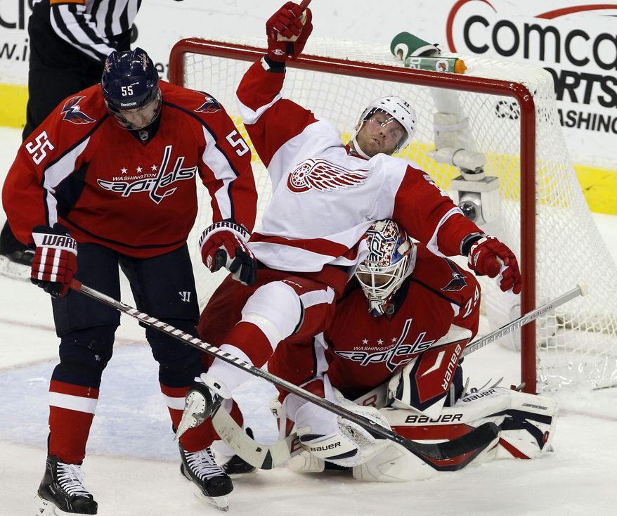 Washington Capitals goaltender Tomas Vokoun set aside 32 of 33 shots on goal against the Detroit Red Wings on Saturday. The Capitals beat the Red Wings 7-1 and Vokoun won his sixth straight game. (AP Photo/Ann Heisenfelt)