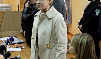 Yulia Tymoshenko, shown with her daughter Evhenya in court on Oct. 11. Mrs. Tymoshenko received a seven-year jail term on charges of abuse of office in signing a gas deal with Russia. (Associated Press)