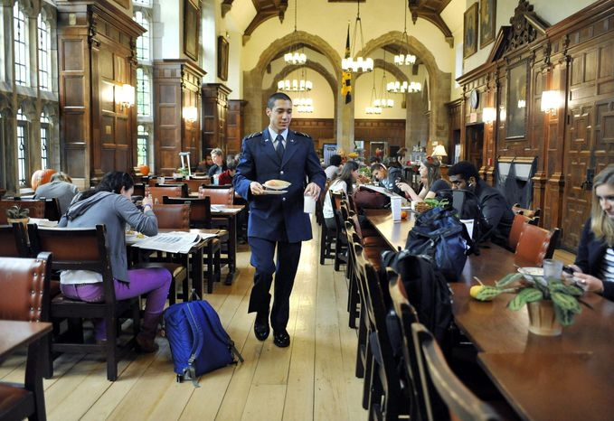 """Andrew Hendricks, the only Air Force cadet at Yale University, may get strange looks but no trouble as he grabs breakfast while wearing his Reserve Officers' Training Corps uniform. """"I think it's mainly that people are really curious because they don't see a lot of military influence on campus,"""" said the sophomore from Fairfax Station, Va. (Associated Press)"""