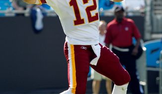 Washington Redskins' John Beck threw for 279 yards, a touchdown and an interception in the loss against the Carolina Panthers. He also rushed for a score. (AP Photo/Bob Leverone)
