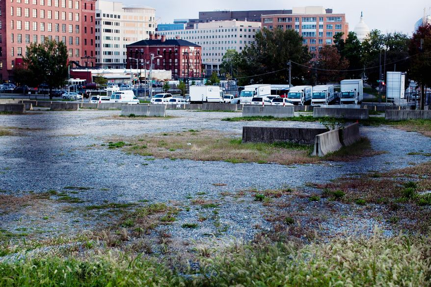 This government-owned lot at the intersection of New Jersey Avenue and H Street Northwest has allowed the Bennett Group to collect tax-free rent for years. It is now proposed for a multimillion-dollar project that includes a Wal-Mart. (T.J. Kirkpatrick/The Washington Times)