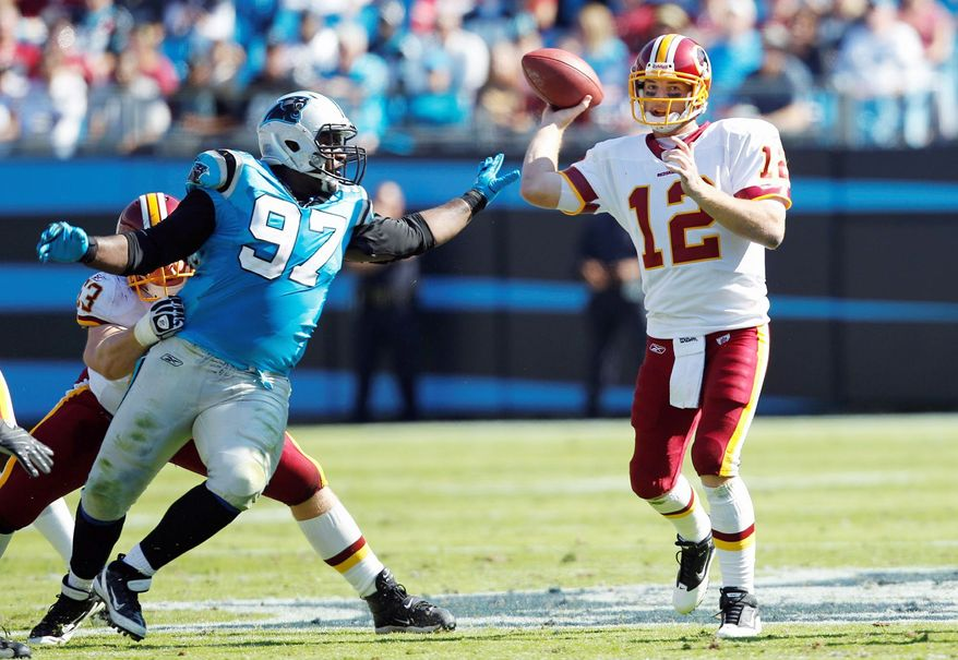 Head coach Mike Shanahan was protective of quarterback John Beck in the first half with his play calls. After halftime, he opened up the offense a bit. Beck had a passer rating of 80.8 in his debut as the Redskins starter Sunday. (Associated Press)