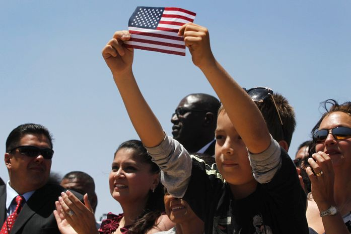 Audience members in El Paso, Texas, listen to President Obama speak about immigration reform in May. Mr. Obama heads out West again for three days on Monday. He will stop first in Las Vegas with a pitch to prod Congress to enact his jobs legislation. (Associated Press)