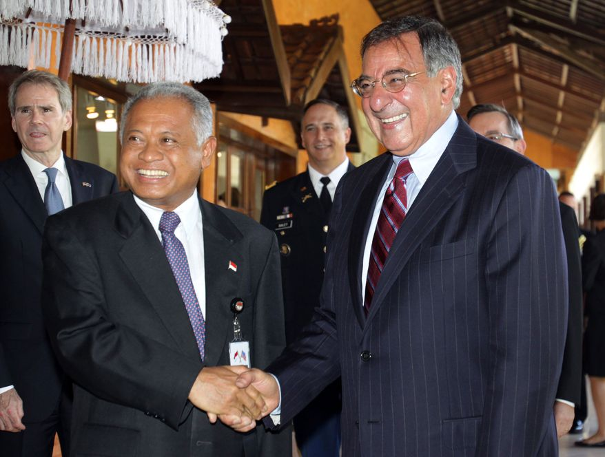 Indonesian Defense Minister Purnomo Yusgiantoro (left) shakes hands with his U.S. counterpart, Defense Secretary Leon E. Panetta, during their meeting in Nusa Dua, Bali, Indonesia, on Sunday, Oct. 23, 2011. (AP Photo/Firdia Lisnawati)