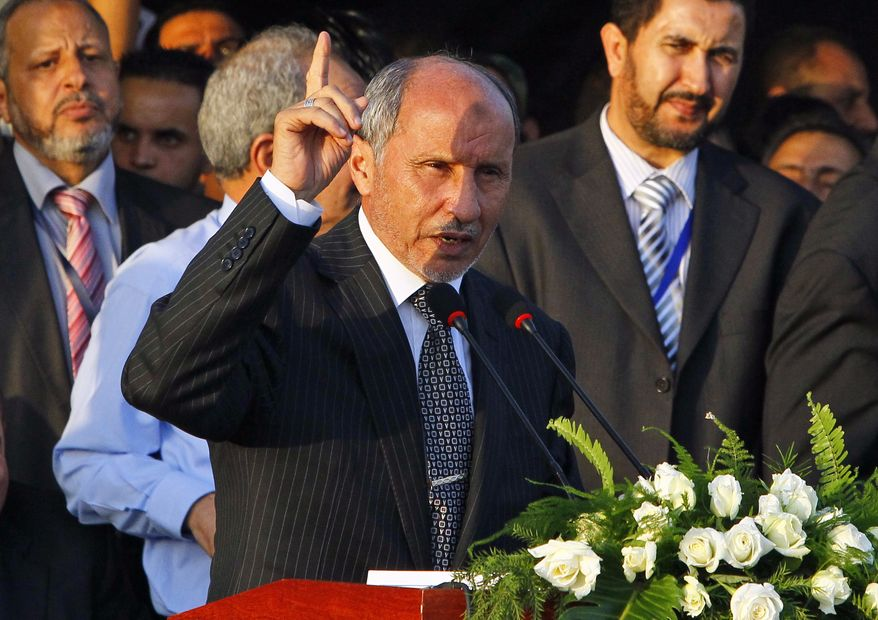 Libyan National Transitional Council chairman Mustafa Abdul-Jalil speaks at Saha Kish Square in Benghazi, Libya, on Sunday, Oct. 23, 2011, as the transitional government declared the liberation of the country after months of bloodshed that culminated in the death of longtime leader Col. Moammar Gadhafi. (AP Photo/Francois Mori)