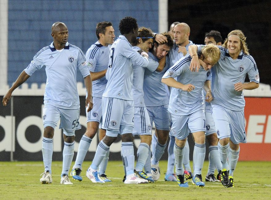 Sporting Kansas City celebrates Matt Besler's goal against the D.C. United during the second half of an MLS soccer game, Saturday, Oct. 22, in Washington. Kansas City won 1-0. (AP Photo/Nick Wass)