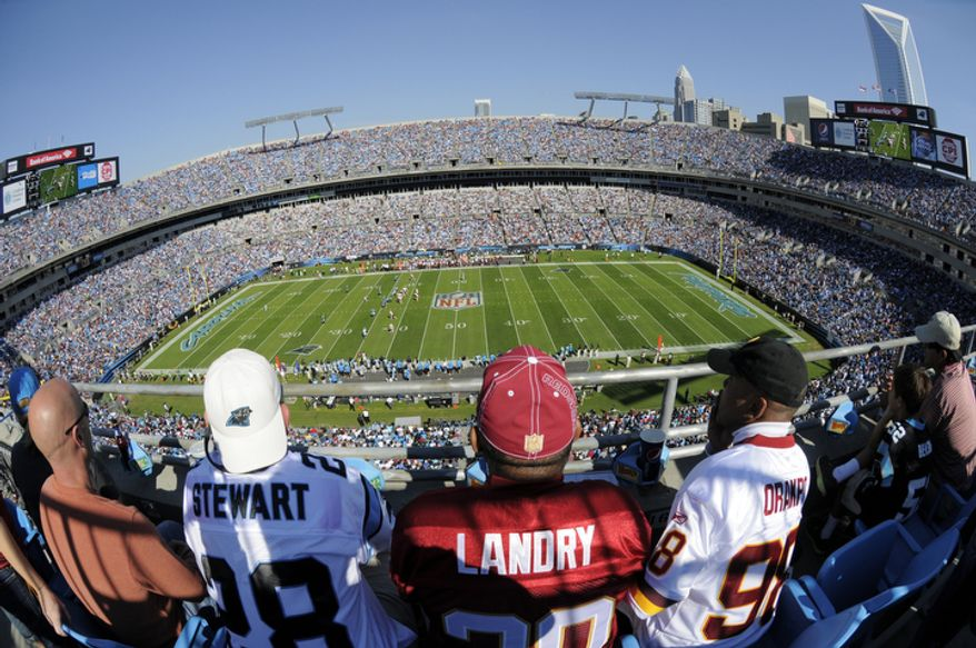 Fans watch during the second quarter of an NFL football game between the Carolina Panthers and the Washington Redskins in Charlotte, N.C., Sunday, Oct. 23, 2011. (AP Photo/Mike McCarn)
