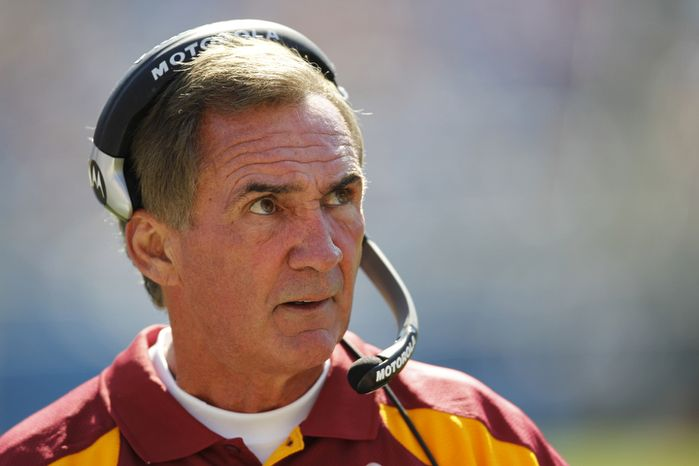 Washington Redskins head coach Mike Shanahan looks on during the first quarter of an NFL football game against the Carolina Panthers in Charlotte, N.C., Sunday, Oct. 23, 2011. (AP Photo/Chuck Burton)