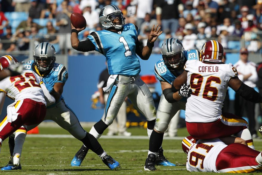 Carolina Panthers' Cam Newton (1) throws a pass against the Washington Redskins during the second quarter of an NFL football game in Charlotte, N.C., Sunday, Oct. 23, 2011. (AP Photo/Chuck Burton)