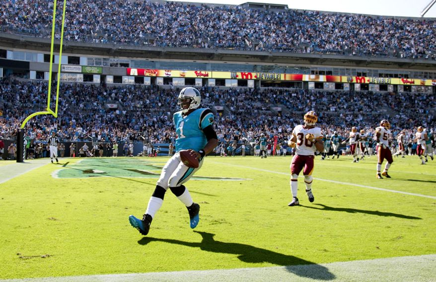 Carolina Panthers' Cam Newton (1) runs into the end zone for a touchdown against the Washington Redskins during the third quarter of an NFL football game in Charlotte, N.C., Sunday, Oct. 23, 2011. (AP Photo/Bob Leverone